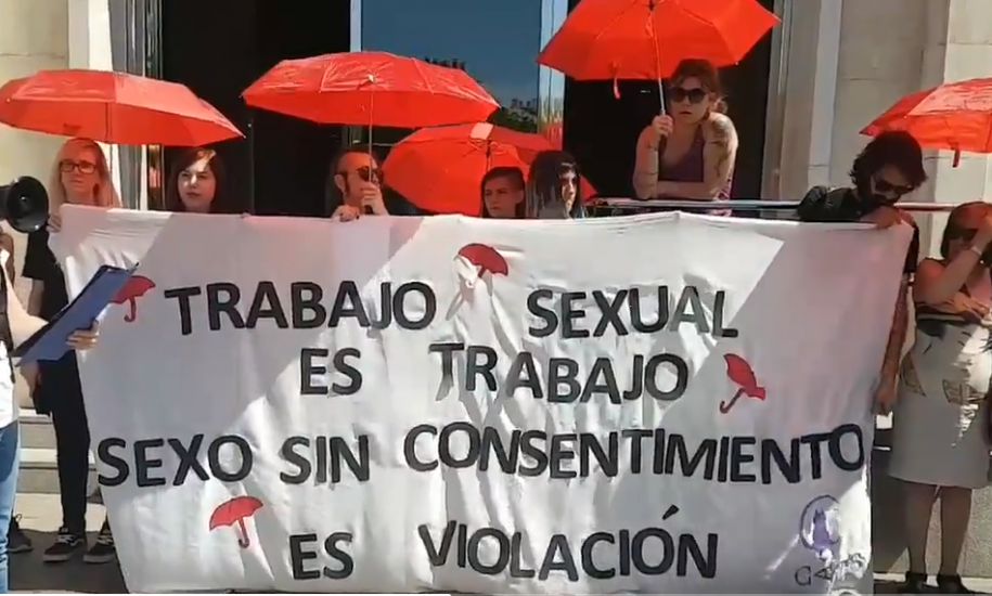 """Asociacion CATS with a banner: """"Sex work is work, sex work without consent is rape"""""""