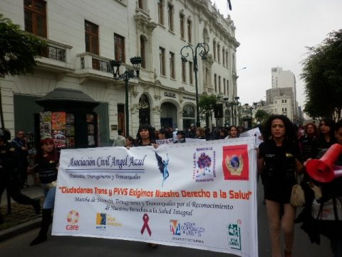 Asociación Civil Angel Azul with a banner